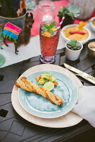 Breadstick on plate on table set for Mexican party
