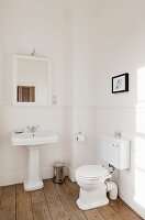 Vintage toilet and sink in minimalist bathroom