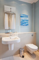 Maritime bathroom in pale blue and sandy shades
