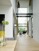 Open-plan, double-height interior of architect-designed house