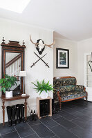 Antique furniture in rustic entrance hall