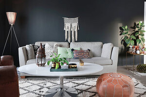 Bohemian-style living room with black wall