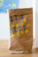 Paper bag printed with pattern of anchors (DIY foam rubber stamp)
