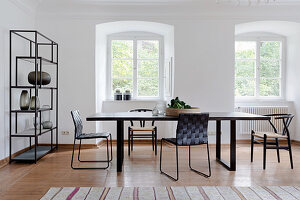 Delicate black furniture in Scandinavian-style dining room