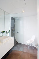 Walk-in shower in modern bathroom with rounded corners