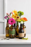 Flowers arranged in beer bottles