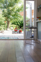 Vintage bar stool in front of open French windows