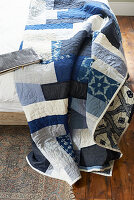 Blue and white quilt on bed