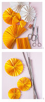 Instructions for making flowers from paper rosettes on sticks