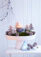 Moss Advent wreath decorated with felt Christmas trees and pine cones
