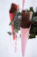 Garland of ivy festively decorated with paper cones and candy canes (detail)