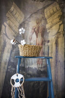 Cotton bolls in basket and dreamcatcher on blue ladder
