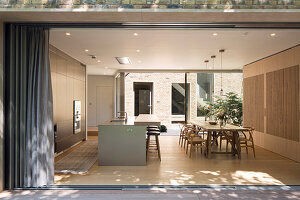 View into open-plan kitchen with dining area from terrace