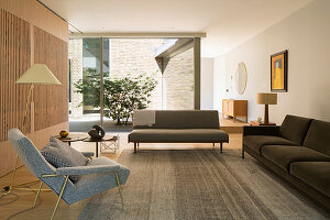 Lounge with view of courtyard through glass wall