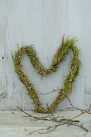 Heart-shaped heather wreath on weathered boards