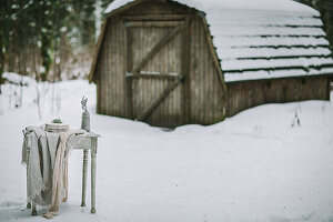 Cake on table in snow