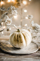 A still life with white pumpkin