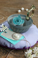 Vintage-style still-life arrangement with bundt-cake tin on round cushion