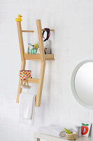 Chair sawn in half used as bathroom shelves