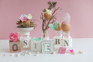 Easter arrangement of lettered cubes and jars, Easter nest, bird, feathers, butterfly and sugar eggs
