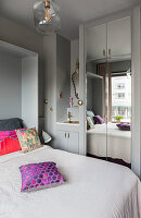 Sink and mirrored cabinet in grey bedroom