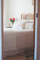 View through open door into country-house bedroom