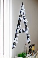 Black decorative letter with white fairy lights