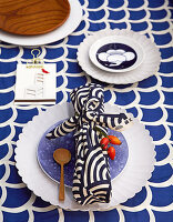 Gift wrapped in patterned blue fabric on plate
