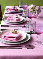 Table set with pink tablecloth and linen napkins