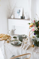 Table decorated in casual style and natural shades for Easter breakfast