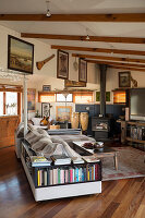 Sofa with integrated bookshelves in rustic living room