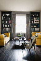 Two yellow sofas in grey and black living room