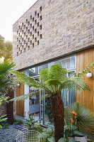 Courtyard facade with perforated brick