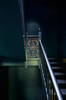 Dark stairwell with antique banister rail