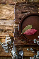 Spring table setting - cutlery on wood
