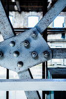 Rivets on pale blue steel girders
