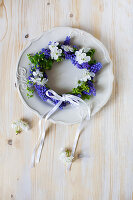 Small wreath of grape hyacinth flowers on plate