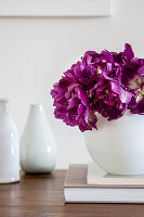 'Purple peony' tulips in white spherical vase