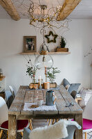 Rustic wooden table and Christmas decorations in dining room