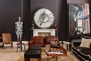 Large clock above fireplace in living room in shades of brown and black