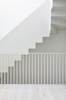 White staircase, balustrade, walls and floor