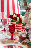 Festively set table decorated in red and white