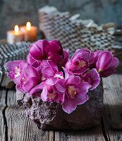 Arrangement of Cymbidium orchids on table