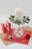 Candlestick made from glass jar with wreath of fir and Christmas-tree bauble