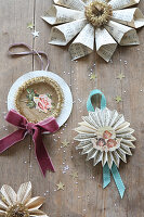 Christmas decorations handcrafted from book pages, scrapbook pictures of rose and angel, ribbons and glitter