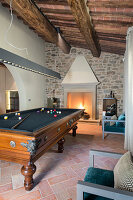 Billiard table in living room of Mediterranean house