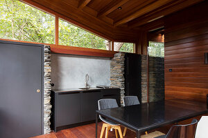 Dining table and small kitchen counter in sustainable, architect-designed house