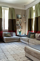 Pale sofa set in living room with tri-coloured curtains