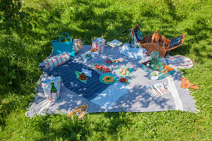 Handmade fabric accessories and snacks on picnic blanket