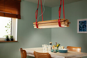 DIY lamp made from lashing straps and wooden laths